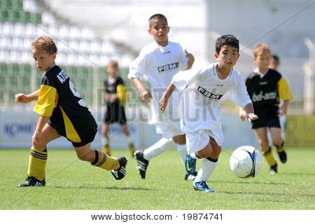 KAPOSVAR, HUNGARY - JULY 24: Unidentified players in action at the V. Youth Football Festival Under 9 Final - Atletico Arad (ROM) vs FC Goldstein (GER) - July 24, 2009 in Kaposvar, Hungary