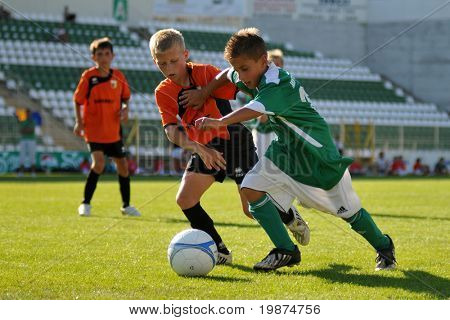 KAPOSVAR, HUNGARY - JULY 24: Unidentified players in action at the V. Youth Football Festival Under 11 Final - MFK OKD Karvina (CZE) vs FC Novi Grad (BIH) - July 24, 2009 in Kaposvar, Hungary