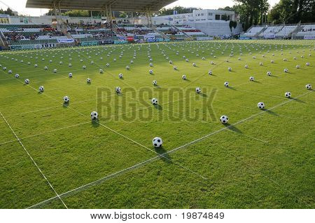 KAPOSVAR, HUNGARY - JULY 23: Many balls at the Guinness world record breaking attempt (Most people keep the football in the air Juggling together) - July 23, 2009 in Kaposvar, Hungary