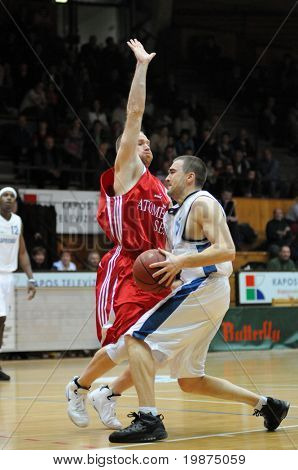 KAPOSVAR, HUNGARY - JANUARY 7: Kestutis Marciulionis (in white) in action at Hungarian National Championship basketball game between Kaposvar and Paks , January 7, 2009 in Kaposvar, Hungary.