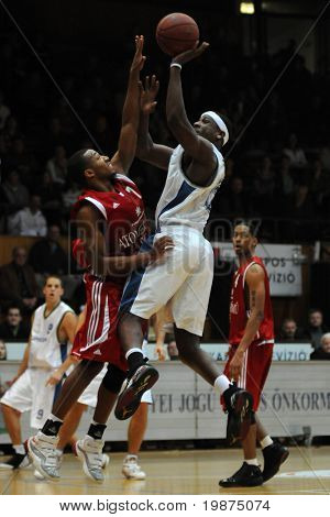 KAPOSVAR, HUNGARY - JANUARY 7: Larry Welton (in white) in action at Hungarian National Championship basketball game between Kaposvar and Paks , January 7, 2009 in Kaposvar, Hungary.