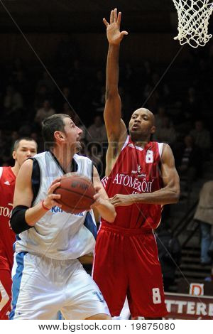 KAPOSVAR, HUNGARY - JANUARY 7: Laszlo Orosz (in white) in action at Hungarian National Championship basketball game between Kaposvar and Paks , January 7, 2009 in Kaposvar, Hungary.
