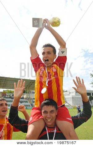 KAPOSVAR, HUNGARY - JULY 25: Bucuresti players rejoice at the V. Youth Football Festival Under 17 Final - Bucuresti (ROM) vs Bresscia SC (ITA) - July 25, 2009 in Kaposvar, Hungary.