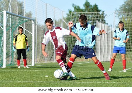 KAPOSVAR, HUNGARY - JULY 25: Unidentified players in action at the V. Youth Football Festival Under 19 Final Rakoczi FC (HUN) vs Toponar (HUN) July 25, 2009 in Kaposvar, Hungary