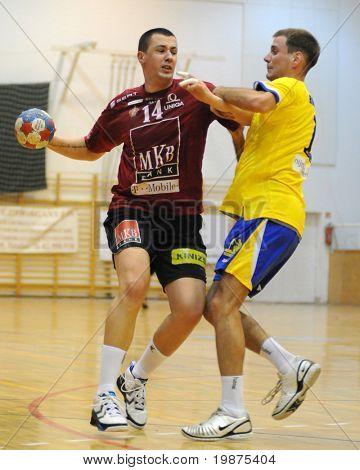 NAGYATAD, HUNGARY - FEBRUARY 5: Marko Vujin (L) holds the ball at Hungarian Cup Handball match (Nagyatad vs. Veszprem) February 5, 2009 in Nagyatad, Hungary.