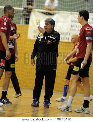 NAGYATAD, HUNGARY - FEBRUARY 5: Lajos Mocsai Veszprem coach (C) gives instruction at Hungarian Cup Handball match (Nagyatad vs. Veszprem) February 5, 2009 in Nagyatad, Hungary.
