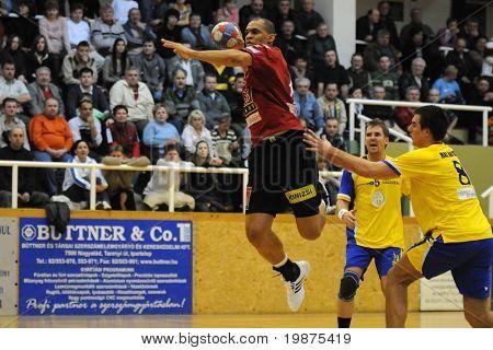 NAGYATAD, HUNGARY - FEBRUARY 5: Perez Carlos (L) makes a throw at Hungarian Cup Handball match (Nagyatad vs. Veszprem) February 5, 2009 in Nagyatad, Hungary.