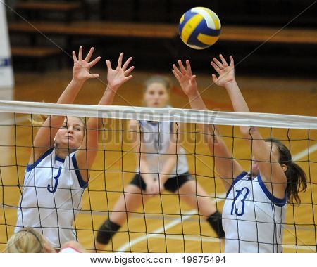 KAPOSVAR, HUNGARY - FEBRUARY 4: Gabriella Serak (3) and Gabriella Kondor (13)blocks the ball in the Hungarian Cup woman volleyball game Kaposvar vs Vasas, February 4, 2009 in Kaposvar, Hungary.
