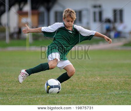 KAPOSVAR, HUNGARY - AUGUST 12: Unidentified soccer player in action at the Hungarian National Championship under 13 game between Kaposvari Rakoczi FC and Sopron SC August 12, 2009 in Kaposvar.