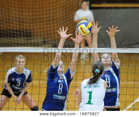 KAPOSVAR, HUNGARY - DECEMBER 17: Timea Kondor (8) and Rebeka Rak (9) blocks the ball at the Hungarian Extra League woman volleyball game Kaposvar vs Miskolc , December 17, 2008 in Kaposvar, Hungary.