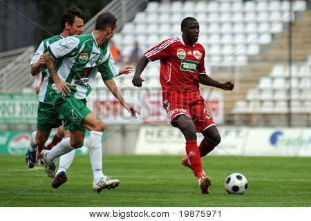 KAPOSVAR, HUNGARY - SEPTEMBER 25: Adamo Coulibaly (R) in action at a Hungarian National Championship soccer game Kaposvar vs Debrecen September 25, 2009 in Kaposvar, Hungary.