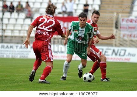 KAPOSVAR, HUNGARY - SEPTEMBER 25: Bernath (L) and Nikolic (C) in action at a Hungarian National Championship soccer game Kaposvar vs Debrecen September 25, 2009 in Kaposvar, Hungary.