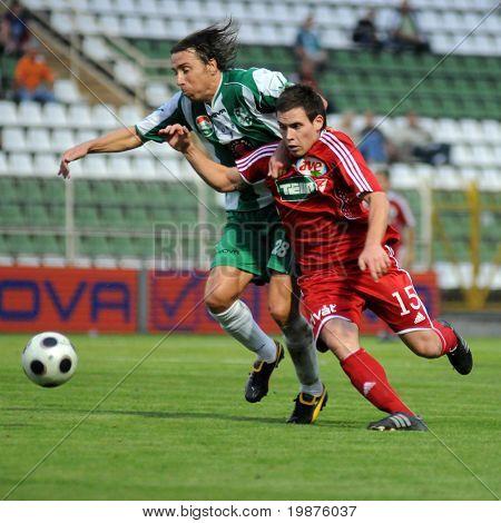KAPOSVAR, HUNGARY - SEPTEMBER 25: Zahorecz (L) and Rezes at a Hungarian National Championship soccer game Kaposvar vs Debrecen September 25, 2009 in Kaposvar, Hungary.