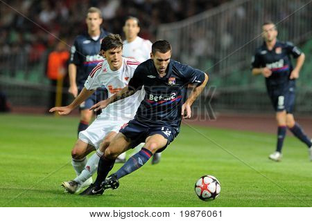 BUDAPEST - SEPTEMBER 29: Laczko (L) and Reveillere in action at the UEFA Champions League football game Debrecen vs Lyon, UEFA Champions League football game, September 29, 2009 in Budapest, Hungary.