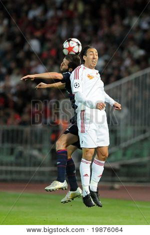 BUDAPEST - SEPTEMBER 29: Leandro (in white) heads the ball at the UEFA Champions League football game Debrecen vs Lyon, UEFA Champions League football game, September 29, 2009 in Budapest, Hungary.