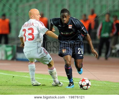 BUDAPEST - SEPTEMBER 29: Varga (L) and Cissokho in action at the UEFA Champions League football game Debrecen vs Lyon, September 29, 2009 in Budapest, Hungary.