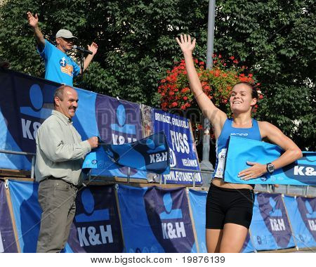KAPOSVAR, HUNGARY - SEPTEMBER 20: Greta Horvath celebrates at the finish line during the K&H Running Day running race September 20, 2009 in Kaposvar, Hungary.
