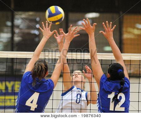 KAPOSVAR, HUNGARY - SEPTEMBER 20: Chovan(4) Kondor (8), and Keppel (12) in action at the Hungarian Extra League woman volleyball game Kaposvar vs Palota, September 20, 2009 in Kaposvar, Hungary