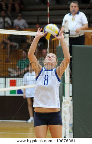 KAPOSVAR, HUNGARY - SEPTEMBER 20: Timea Kondor posts the ball at the Hungarian Extra League woman volleyball game Kaposvar vs Palota, September 20, 2009 in Kaposvar, Hungary