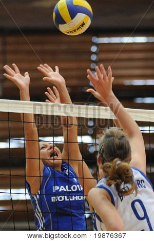 KAPOSVAR, HUNGARY - SEPTEMBER 20: Unidentified players blocks the ball at the Hungarian Extra League woman volleyball game Kaposvar vs Palota, September 20, 2009 in Kaposvar, Hungary