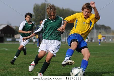 KAPOSVAR, HUNGARY - OCTOBER 10: Unidentified soccer players in action at the Hungarian National Championship under 13 game between Kaposvari Rakoczi FC and Puskas Academy on October 10, 2009 in Kaposvar, Hungary.