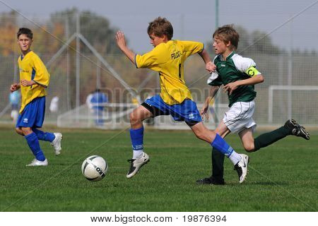 KAPOSVAR, HUNGARY - OCTOBER 10: Unidentified soccer players in action at the Hungarian National Championship under 13 game between Kaposvari Rakoczi FC and Puskas Academy on October 10, 2009 in Kaposvar, Hungary.