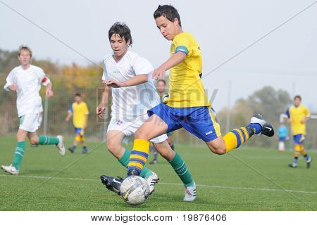 KAPOSVAR, HUNGARY - OCTOBER 10: Unidentified soccer players in action at the Hungarian National Championship under 15 game between Kaposvari Rakoczi FC and Puskas Academy October 10, 2009 in Kaposvar.