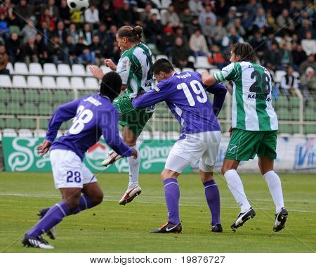 KAPOSVAR, HUNGARY - OCTOBER 17: Jucemar (L) Maroti (top), Vasko and Zahorecz (R) in action at a Hungarian National Championship soccer game Kaposvar vs Ujpest October 17, 2009 in Kaposvar, Hungary.