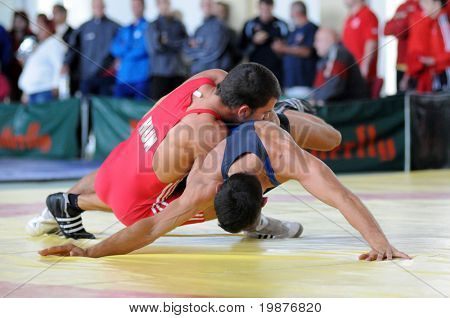KAPOSVAR, HUNGARY - OCTOBER 18: Two competitors wrestle in the Hungarian Wrestling Team Championship, October 18, 2009 in Kaposvar, Hungary.