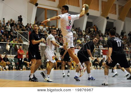 CSURGO, HUNGARY - OCTOBER 21: Zarko Sesum (with the ball) in action at Hungarian National Handball Championship match (Csurgo vs. Veszprem) October 21, 2009 in Siofok, Hungary.