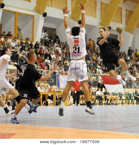 CSURGO, HUNGARY - OCTOBER 21: Gabor Olah (with the ball) in action at Hungarian National Handball Championship match (Csurgo vs. Veszprem) October 21, 2009 in Siofok, Hungary.