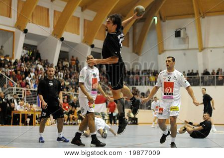 CSURGO, HUNGARY - OCTOBER 21: Tibor Kokeny(with the ball) in action at Hungarian National Handball Championship match (Csurgo vs. Veszprem) October 21, 2009 in Siofok, Hungary.