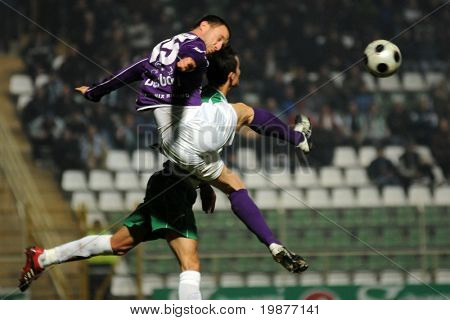 KAPOSVAR, HUNGARY - OCTOBER 31: Gyagya (15) and Szepessy (in green) in action at a Hungarian National Championship soccer game Kaposvar vs Kecskemet October 31, 2009 in Kaposvar, Hungary.