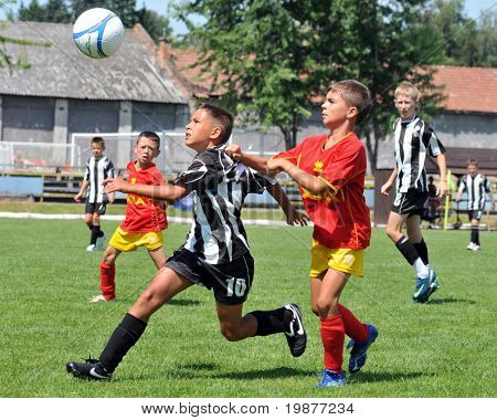 KAPOSVAR, HUNGARY - JULY 21: Unidentified players in action at the V. Youth Football Festival match - July 21, 2009 in Kaposvar, Hungary
