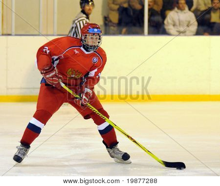 KAPOSVAR, HUNGARY - NOVEMBER 6: Russian player in action at the friendly ice hockey match with Hungarian and Russian Youth National Team, November 6, 2009 in Kaposvar, Hungary.