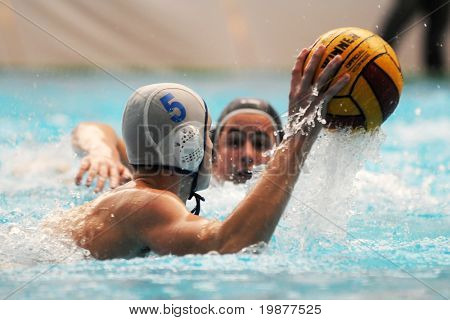 KAPOSVAR, HUNGARY - NOVEMBER 14: Jozsef Berta (5) in action at a Hungarian National Championship water-polo game (Kaposvar vs Kecskemet), November 14, 2009 in Kaposvar, Hungary