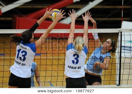 KAPOSVAR, HUNGARY - OCTOBER 25: Toth (L), Dancs (C) and Kondor (R) in action at the Hungarian NB I. League woman volleyball game Kaposvar vs Eger, October 25, 2009 in Kaposvar, Hungary.