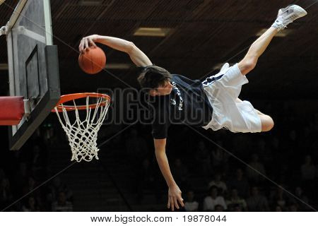 KAPOSVAR, HUNGARY - DECEMBER 6: An unidentified player in action at FACE TEAM Acrobatic Basketball Show, December 6, 2009 in Kaposvar, Hungary