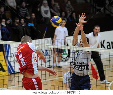 KAPOSVAR, HUNGARY - DECEMBER 8: Nemec (10) and Nagy (3) in action at a CEV Cup volleyball game Kaposvar (HUN) vs Hotvolleys Wien (AUT), December 8, 2009 in Kaposvar, Hungary