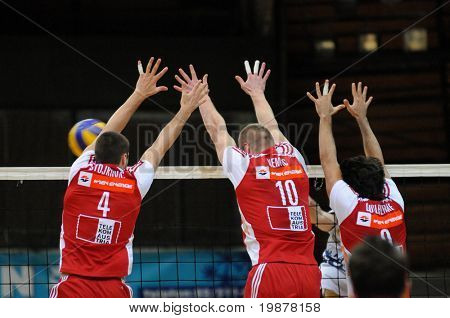 KAPOSVAR, HUNGARY - DECEMBER 8: Stojkovic (L), Nemec (C) and Guilherme (R) blocks the ball at a CEV Cup volleyball game Kaposvar (HUN) vs Hotvolleys Wien (AUT), December 8, 2009 in Kaposvar, Hungary
