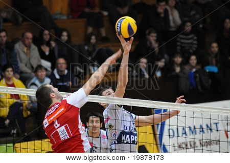 KAPOSVAR, HUNGARY - DECEMBER 8: Stojkovic (L) and Schulcz (R) in action at a CEV Cup volleyball game Kaposvar (HUN) vs Hotvolleys Wien (AUT), December 8, 2009 in Kaposvar, Hungary