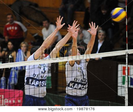 KAPOSVAR, HUNGARY - DECEMBER 8: Nagy (L) and Kantor (R) blocks the ball at a CEV Cup volleyball game Kaposvar (HUN) vs Hotvolleys Wien (AUT), December 8, 2009 in Kaposvar, Hungary