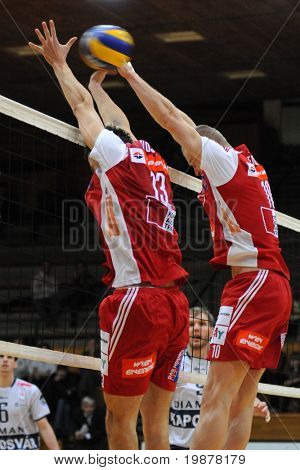 KAPOSVAR, HUNGARY - DECEMBER 8: Nojic (L) and Nemec (R) blocks the ball at a CEV Cup volleyball game Kaposvar (HUN) vs Hotvolleys Wien (AUT), December 8, 2009 in Kaposvar, Hungary