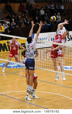 KAPOSVAR, HUNGARY - DECEMBER 8: Unidentified players in action at a CEV Cup volleyball game Kaposvar (HUN) vs Hotvolleys Wien (AUT), December 8, 2009 in Kaposvar, Hungary