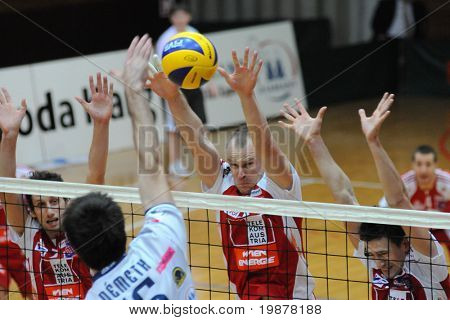 KAPOSVAR, HUNGARY - DECEMBER 8: Unidentified players blocks the ball at a CEV Cup volleyball game Kaposvar (HUN) vs Hotvolleys Wien (AUT), December 8, 2009 in Kaposvar, Hungary