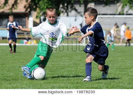 KAPOSVAR, HUNGARY - JULY 20: Unidentified players in action at the V. Youth Football Festival match - July 20, 2009 in Kaposvar, Hungary.