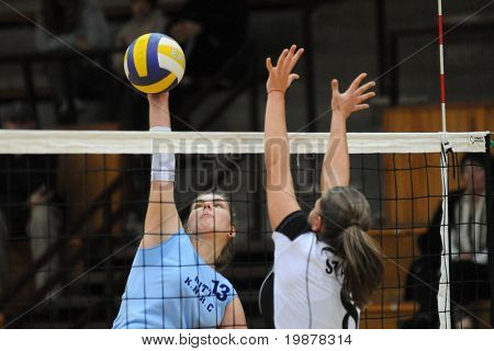 KAPOSVAR, HUNGARY - NOVEMBER 15: Gabriella Kondor (L) and Szalai (R) in action at the Hungarian NB I. League woman volleyball game Kaposvar vs Nyiregyhaza, November 15, 2009 in Kaposvar, Hungary.