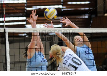 KAPOSVAR, HUNGARY - NOVEMBER 15: Palfy (L), Sipos (C) and T.Kondor (R) in action at the Hungarian NB I. League woman volleyball game Kaposvar vs Nyiregyhaza, November 15, 2009 in Kaposvar, Hungary.