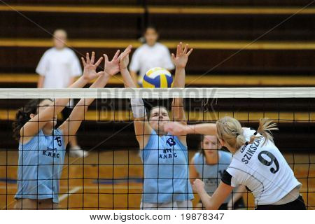 KAPOSVAR, HUNGARY - NOVEMBER 15: Horvath (15), Kondor (13) and Szikszai in action at the Hungarian NB I. League woman volleyball game Kaposvar vs Nyiregyhaza, November 15, 2009 in Kaposvar, Hungary.