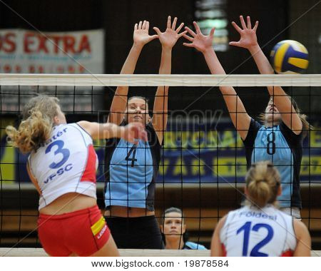 KAPOSVAR, HUNGARY - JANUARY 10: Czmerk (4) and Kondor T. (8) block the ball at the Hungarian NB I. League woman volleyball game Kaposvar vs Veszprem, January 10, 2010 in Kaposvar, Hungary.